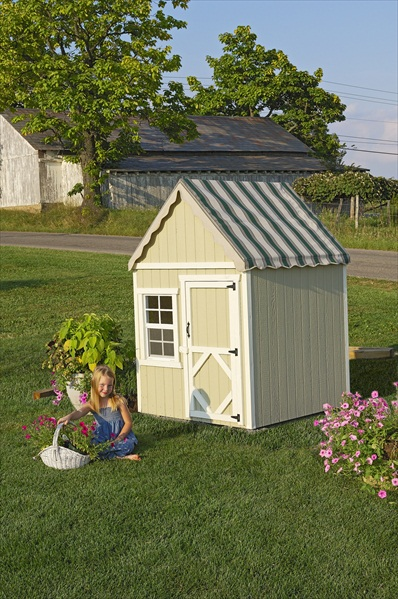 small wooden playhouse perfect for small outdoor spaces