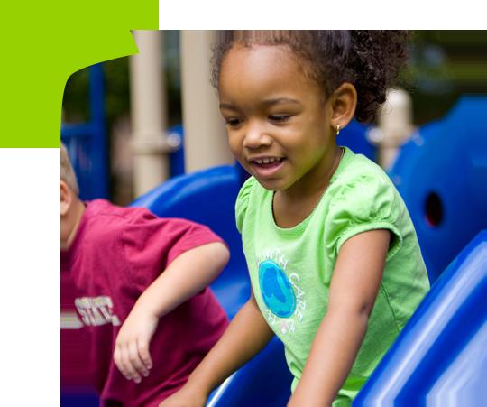 girl getting off playground slde