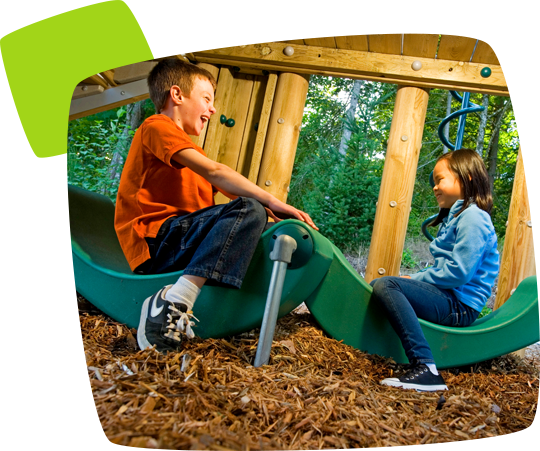 kids playing on a teeter-totter toy
